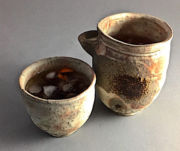 An equal parts Manhattan Wood fired Shigaraki cup and pourer by Kenzo Ozawa