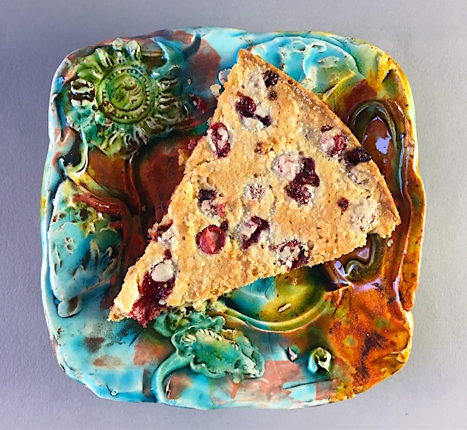 Slice of warm cranberry torte Earthenware plate by Lisa Orr