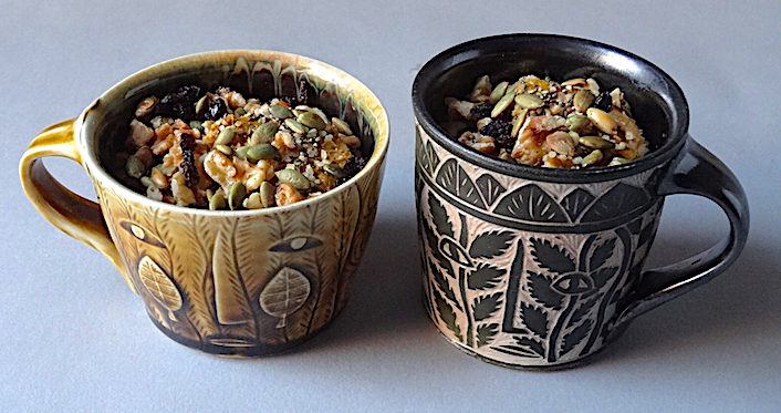 Pumpkin pudding with nuts, seeds and currants Carved mugs by Matthew Metz