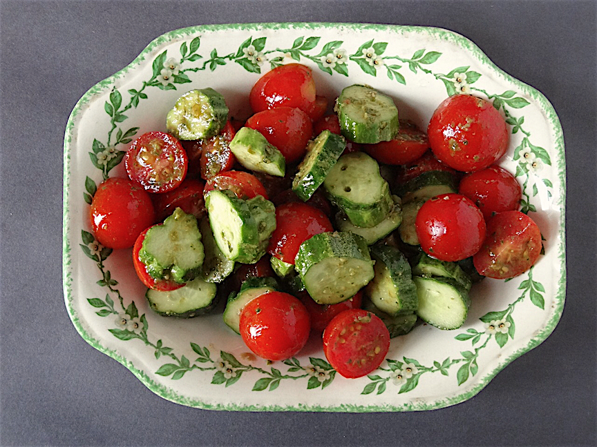 Tomato and cucumber salad with pesto vinaigrette