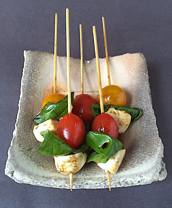 Caprese hors d'oeuvre with cherry tomatoes and bocconcini Plate by Simon Levin
