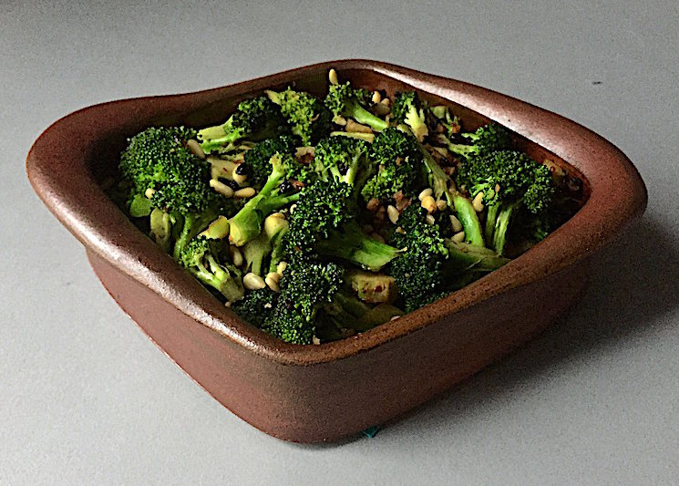 Broccoli with Garlic, Currants, Chili Flakes and Pine Nuts Flameware Casserole Dish by Robbie Lobell