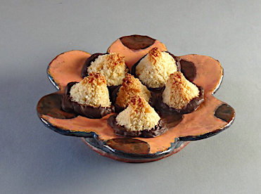 Chocolate dipped coconut haystacks Earthenware flower plate by Holly Walker