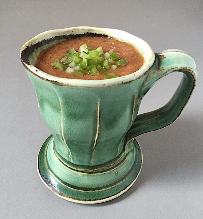 Summer Gazpacho with chopped cucumber, green pepper and jalapeño Soda-fired mug by Gertrude Graham Smith