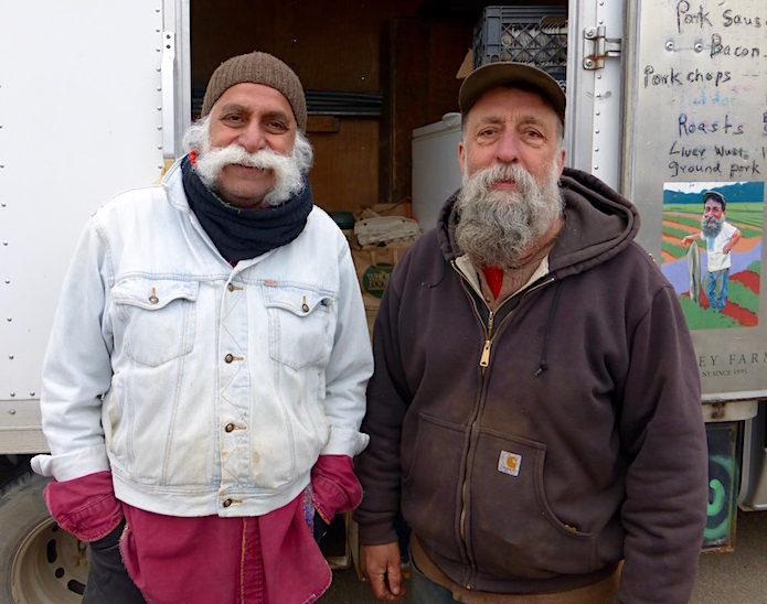 Ray (right) and his sales associate Hardeep Maharawal at the Grand Army Plaza Greenmarket in early spring