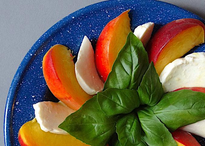Peaches, mozzarella and fresh basil leaves